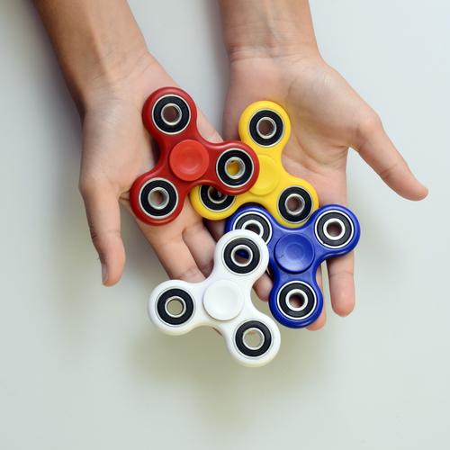 Kids Using Fidget Spinners at School