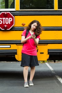 Example of Digital Divide: Girl doing homework with school bus wifi