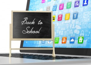 Back To school technology, a chalkboard sign with a computer